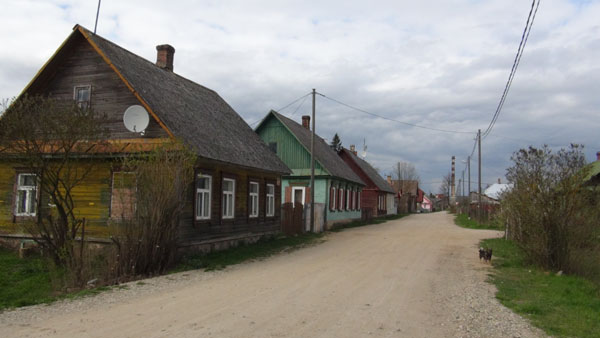 Old wooden homes in Grīva