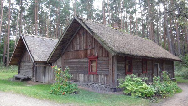 A Russian farmstead moved to Riga Skansen from Latgale, with iconic red window decorations