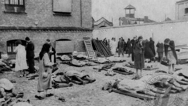 Latvians attempt to recognize the mutilated bodies of their relatives who were murdered by Soviets in Riga