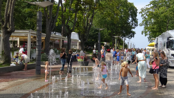 People enjoying summer in a main street of Majori village