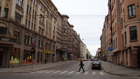 A typical long straight street of Riga Centrs, surrounded by large old buildings
